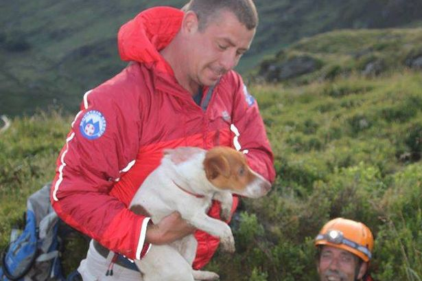 The moment South Snowdonia Mountain Rescue Team volunteers Bryn (in the hole) and Dion, saved Tess